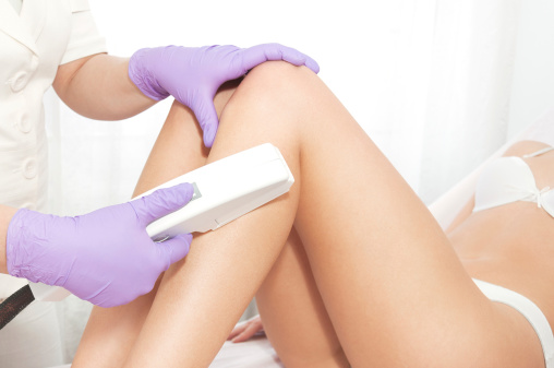 Woman receiving laser hair removal treatment